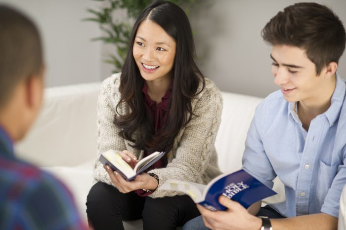 teenagers chat in their cell group holding bibles